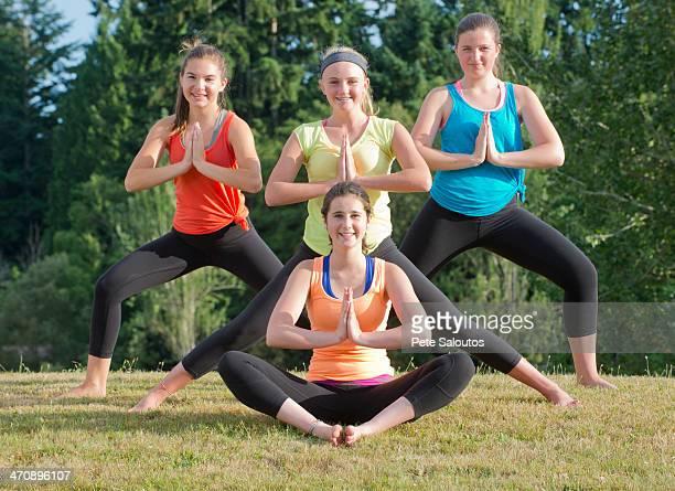 Teenage girls doing yoga in prayer position