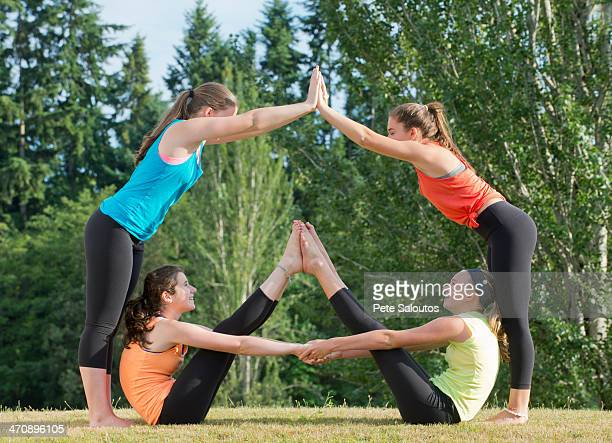 teenage girls doing yoga - bending over stock pictures, royalty-free photos & images