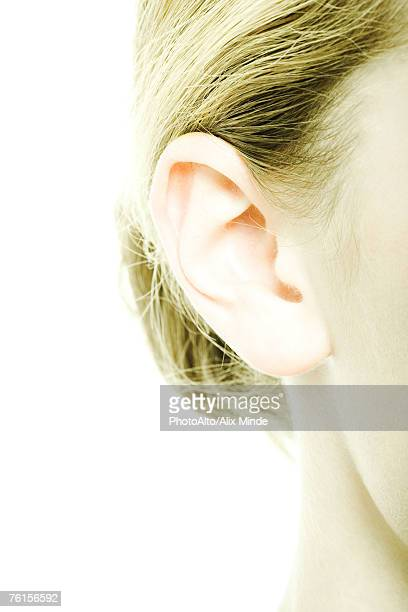 'Teenage girl's ear, extreme close-up'