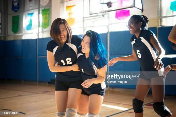 Teenage girls enjoying at volleyball court
