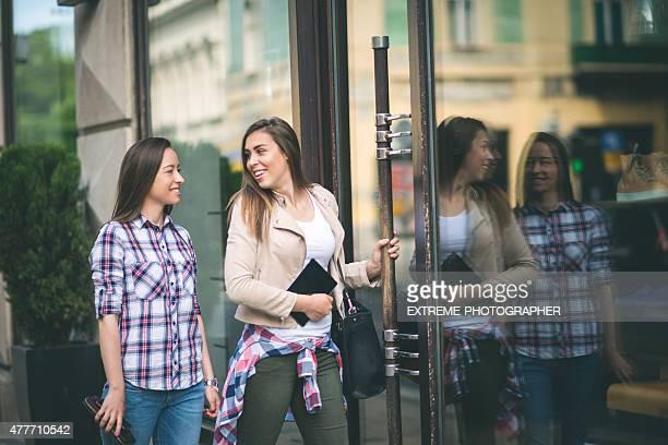 Teenage girls entering the store