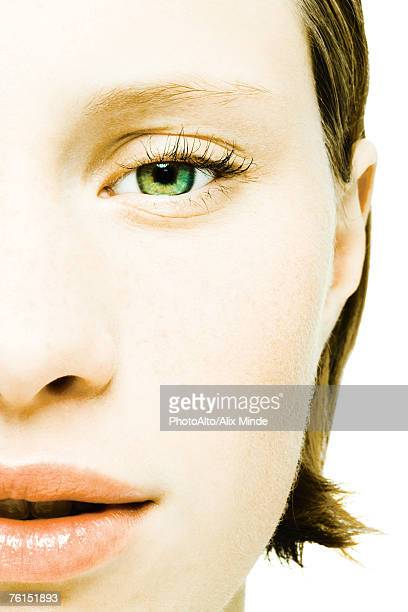 'Teenage girl's face, extreme close-up'
