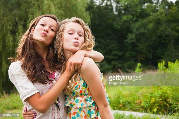 Teenage girls fooling around and puckering lips