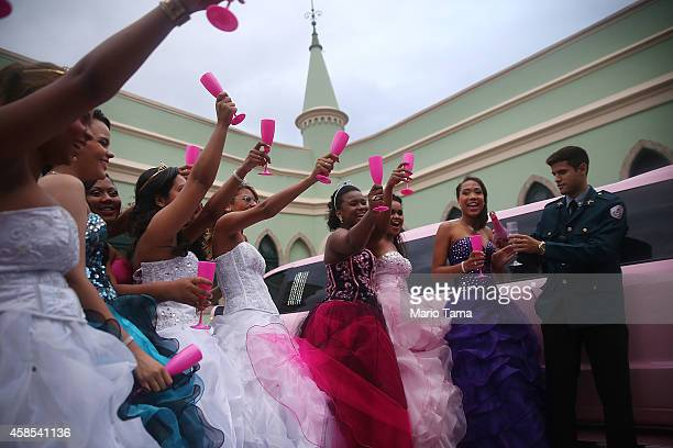 Teenage girls from the CerroCora 'favela' or community celebrate with a UPP officer at a group debutante ball at Ilha Fiscal castle organized by the...