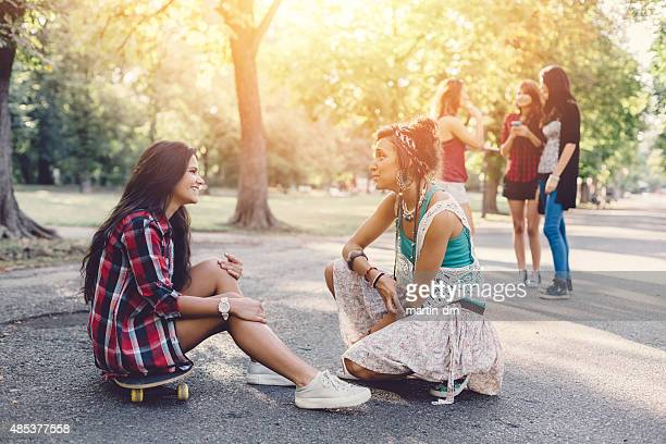Teenage girls gathering in  the park