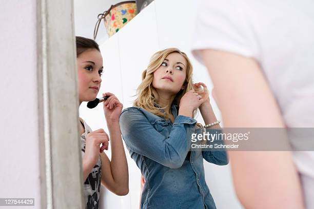 Teenage girls getting dressed up