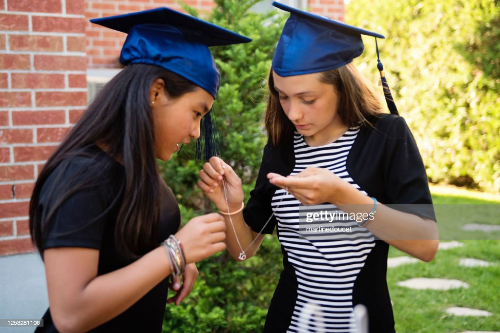 Teenage girls graduation from primary school party in backyard. : Stock Photo