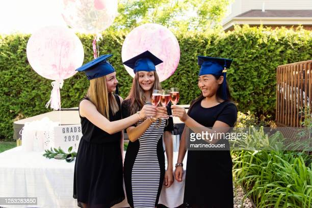 """teenage girls graduation from primary school party in backyard. - """"martine doucet"""" or martinedoucet stock pictures, royalty-free photos & images"""