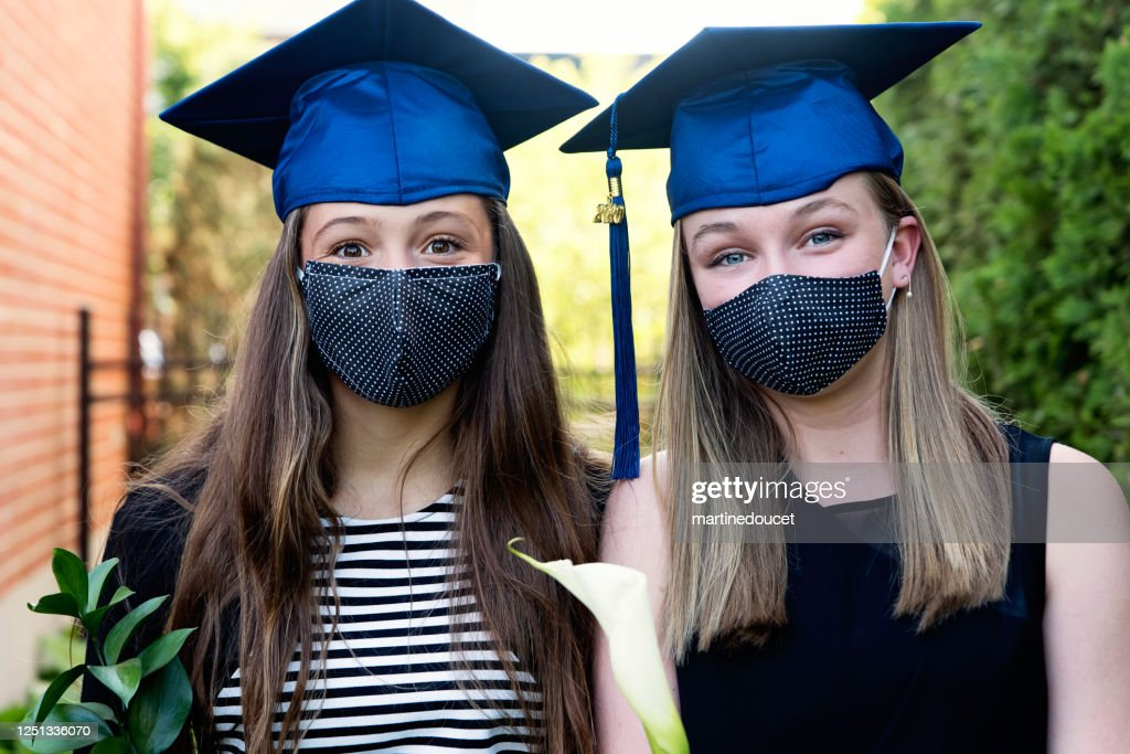 Teenage girls graduation from primary school portrait with protective mask. : Stock Photo