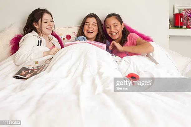 teenage girls having fun in bed