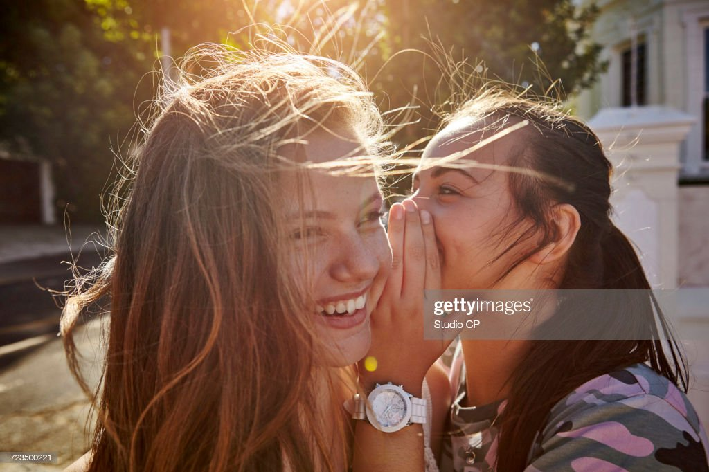 Teenage girls having fun in residential street, Cape Town, South Africa : Stock Photo