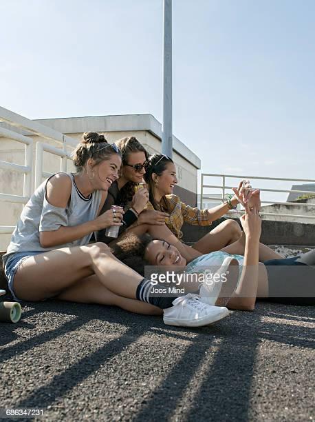 Teenage girls having fun,  using smartphones