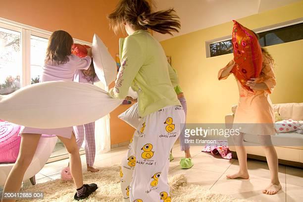 Teenage girls (12-17) having pillow fight