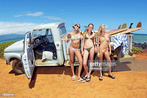 teenage girls in bikinis with truck - flip flops stock pictures, royalty-free photos & images