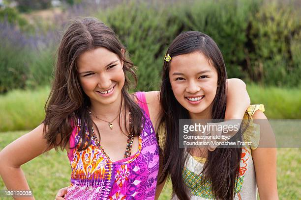 "teenage girls (14-15) in garden, portrait, smiling - ""compassionate eye"" stock-fotos und bilder"