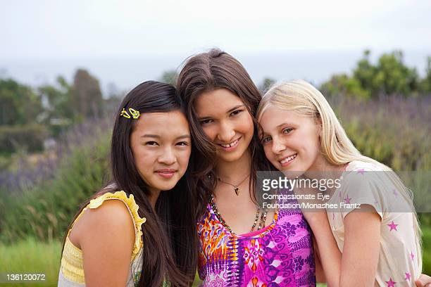 teenage girls in garden, portrait, smiling - cef do not delete stock pictures, royalty-free photos & images