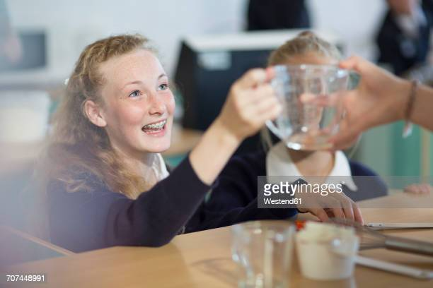 teenage girls in high school cooking class - measuring cup stock pictures, royalty-free photos & images