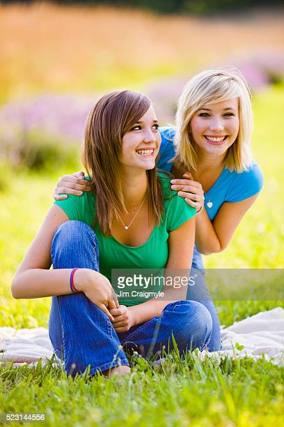 teenage girls in meadow - jim craigmyle stock pictures, royalty-free photos & images