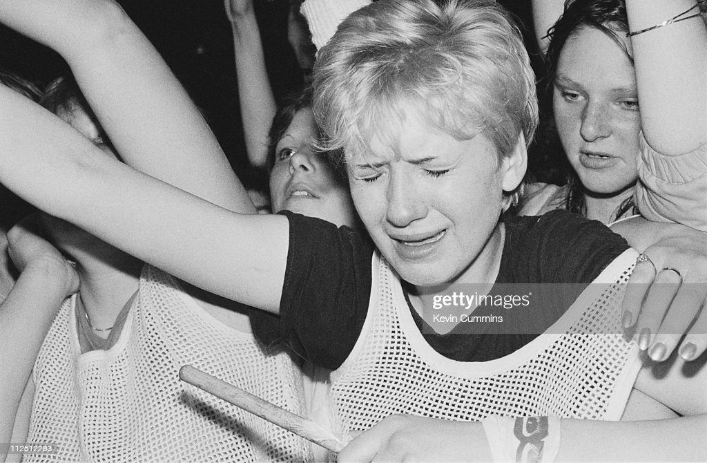 Teenage girls in the audience at a concert by British pop group Kajagoogoo, circa 1983.