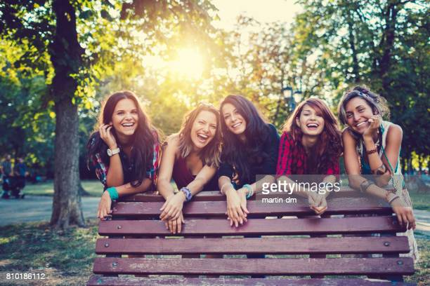 Teenage girls in the park smiling to the camera