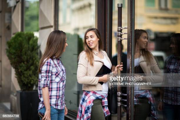 teenage girls in the street with tablet device - entering stock pictures, royalty-free photos & images