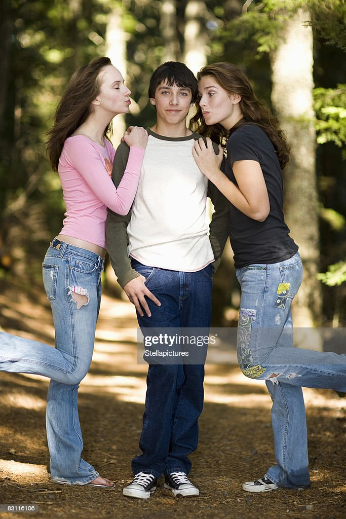 Teenage Girls Kissing Teenage Boy High-Res Stock Photo - Getty Images-4049