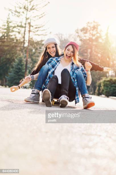 Teenage girls laughing in the park