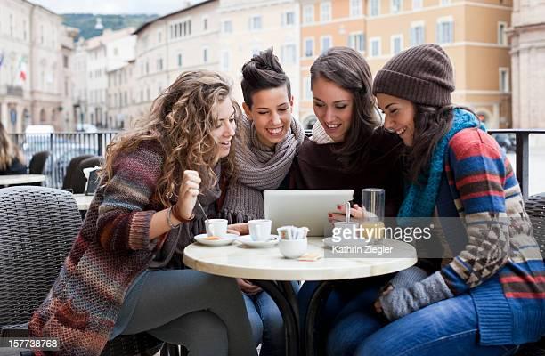 teenage girls looking at digital tablet together