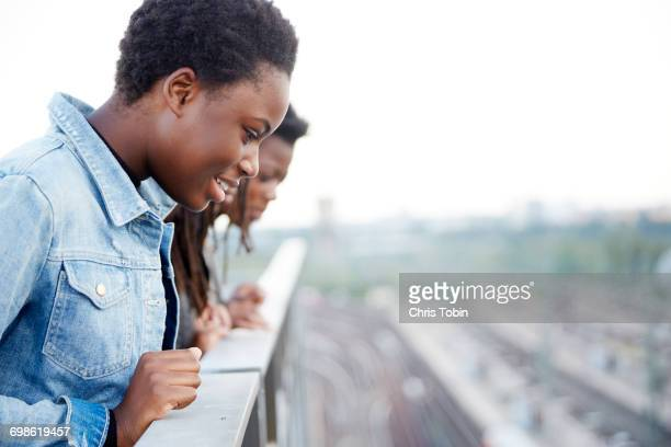 Teenage girls looking down on city