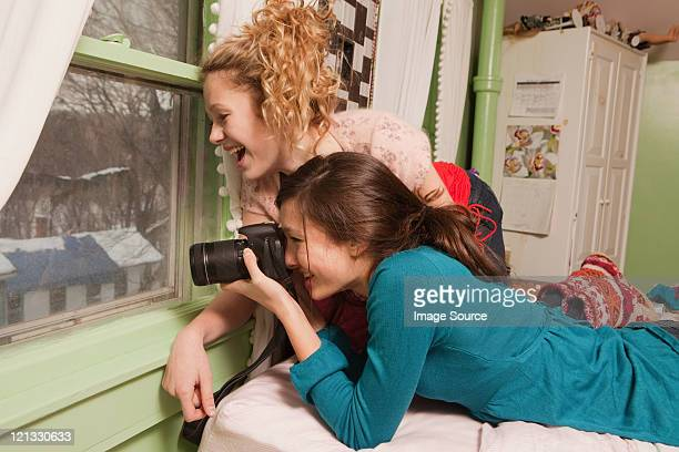 teenage girls looking through window taking photograph - chatham new york state stock pictures, royalty-free photos & images