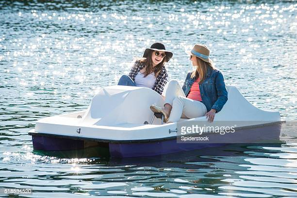 teenage girls on a paddle boat - pedal boat stock pictures, royalty-free photos & images