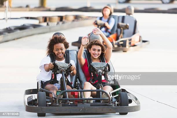 Teenage girls on go cart