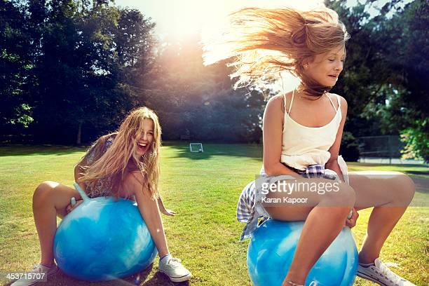 teenage girls on space hopper - carefree stock pictures, royalty-free photos & images