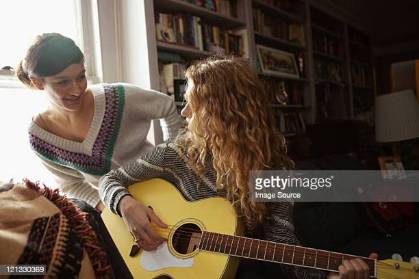 teenage girls, one playing guitar - chatham new york state stock pictures, royalty-free photos & images