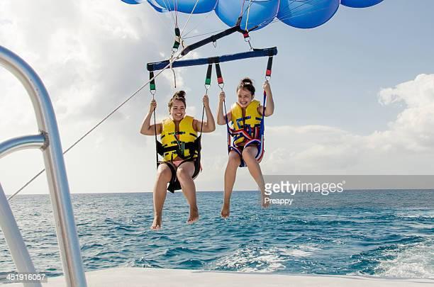 Teenage girls parasailing