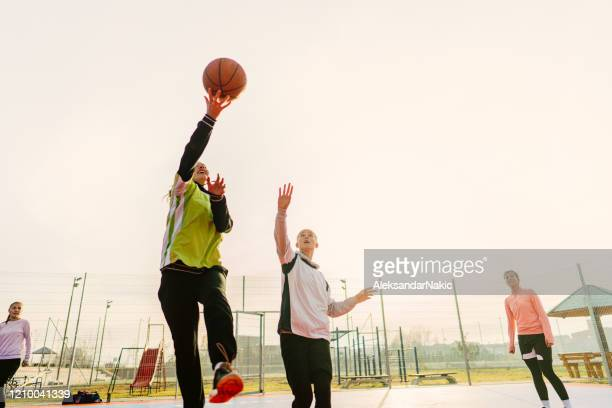 teenage girls playing basketball - sports equipment stock pictures, royalty-free photos & images