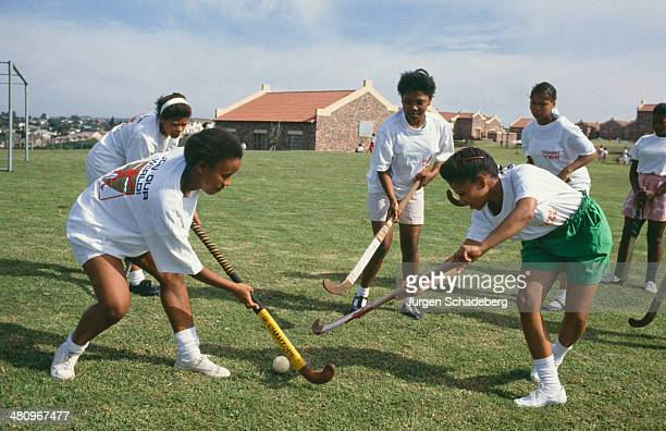 Teenage girls playing hockey in South Africa circa 1990