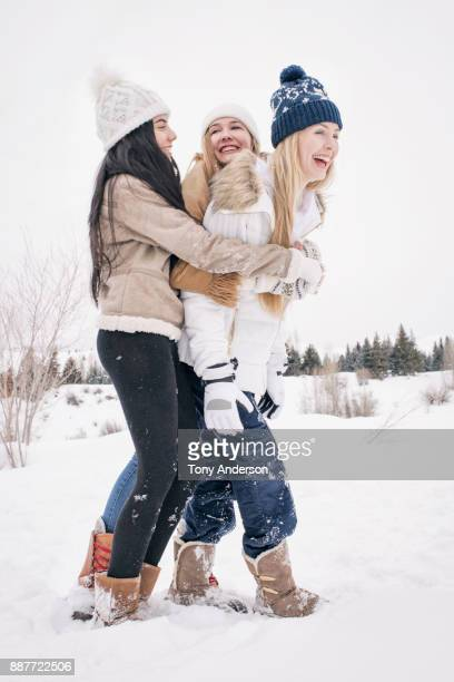 teenage girls playing in the snow - girl wrestling stock pictures, royalty-free photos & images
