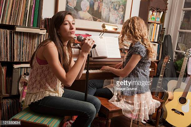 teenage girls playing piano and singing - chatham new york state stock pictures, royalty-free photos & images