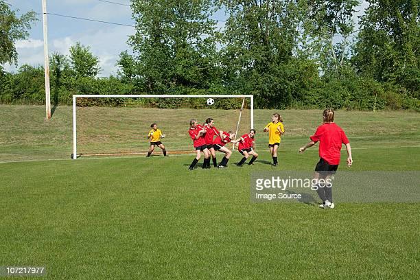 Teenage girls playing soccer