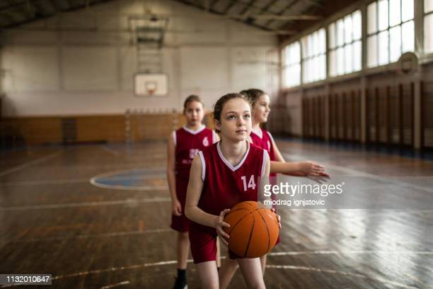 teenage girls practicing free throws - school girl shoes stock pictures, royalty-free photos & images