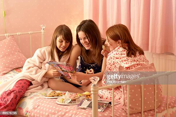 teenage girls reading magazines - slumber party stock pictures, royalty-free photos & images