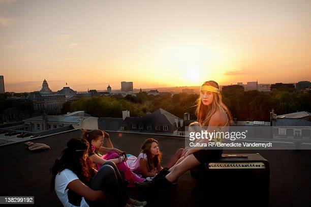 Teenage girls relaxing on roof
