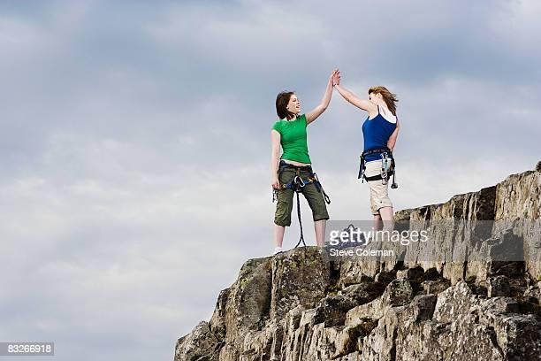Teenage girls rock climbing
