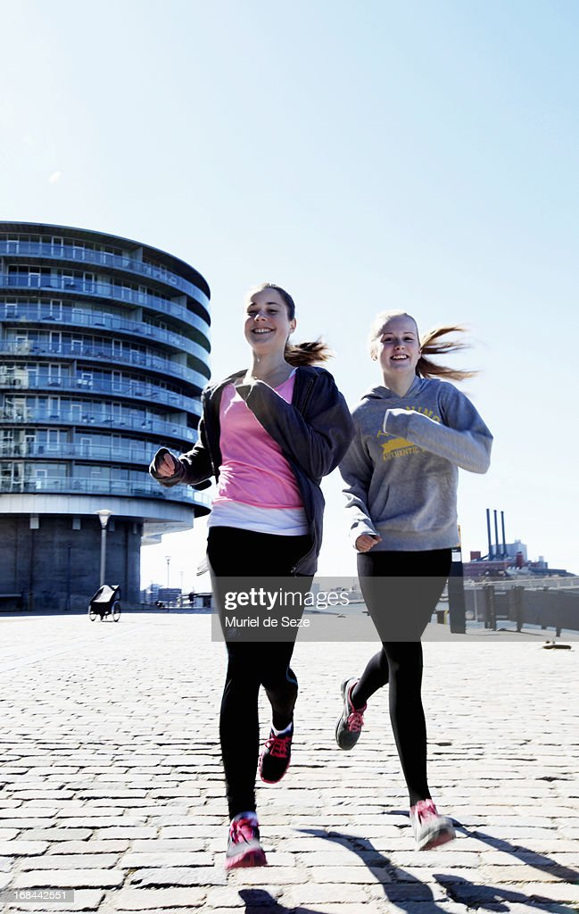 Teenage girls running : Stock Photo