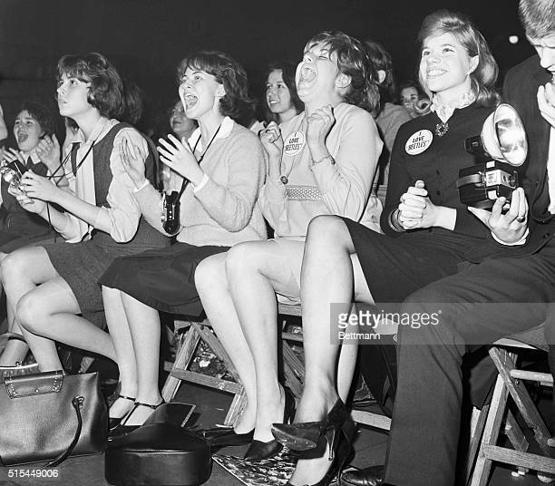 Teenage girls scream with enthusiasm as they watch their heroes The Beatles perform at the Washington DC Coliseum