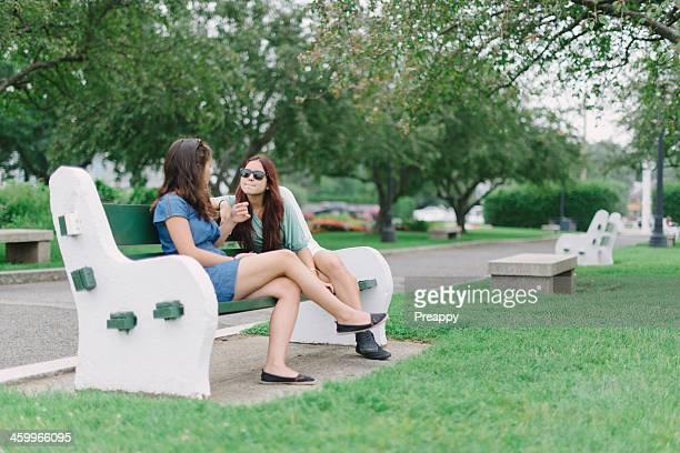 Teenage girls socializing at the park