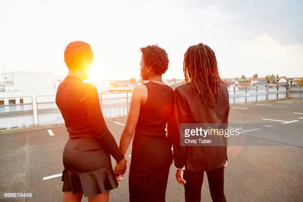 teenage girls standing together sunset - leanincollection stock pictures, royalty-free photos & images