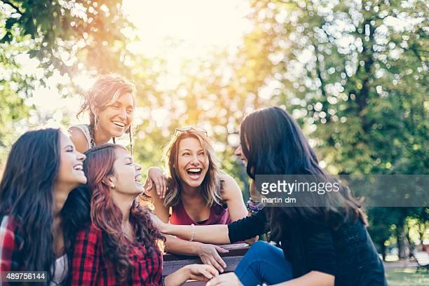 Teenage girls storytelling in  the park