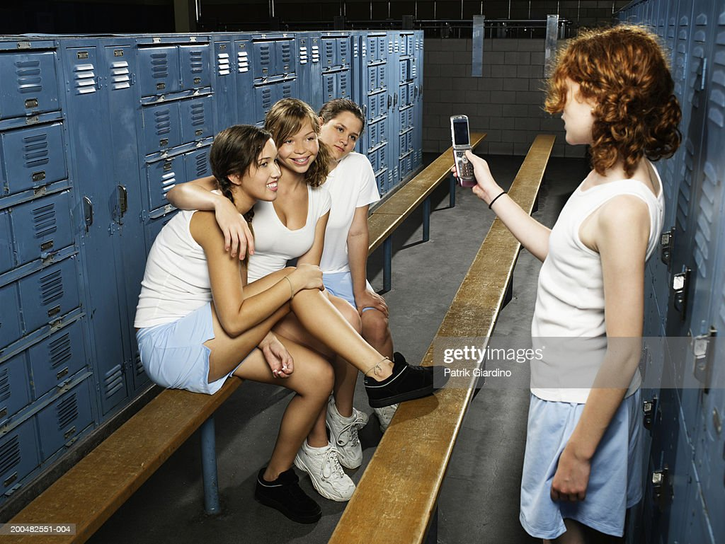 Teenage Girls Taking Picture With Mobile Phone In Gym Locker Room ...